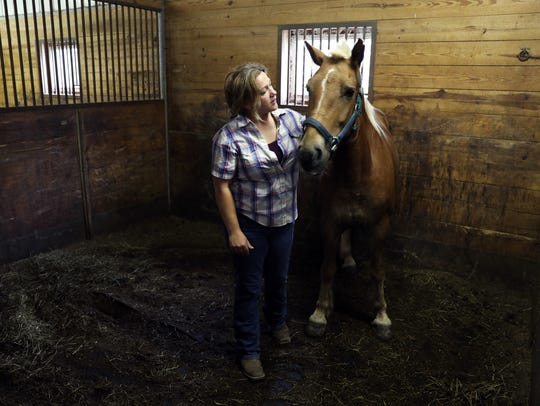 Julie Copper visits with a horse recently rescued from