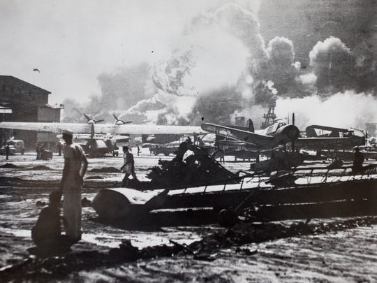 Fires burn on an airfield after the surprise attack by Japanese forces on Pearl Harbor Dec. 7, 1941. Photo courtesy of the University of Arizona Special Collections.
