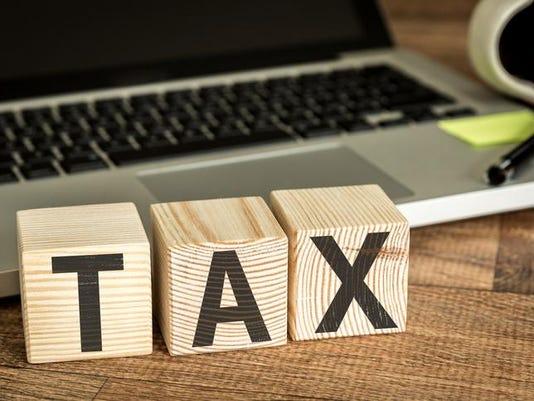 Tax written on a wooden cube