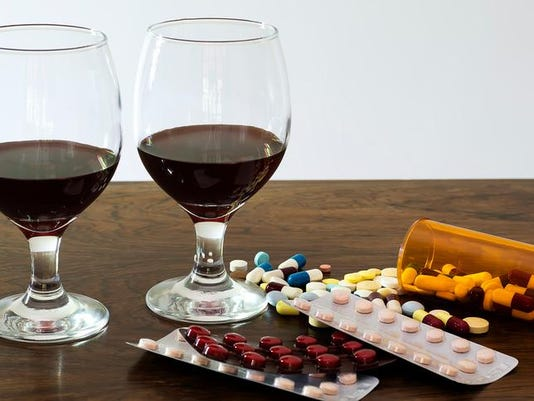Two glasses of wine near medications