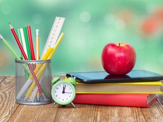 School supplies on green empty space background.