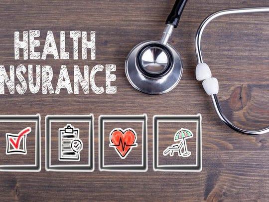 Health Insurance. Stethoscope on wooden desk background.
