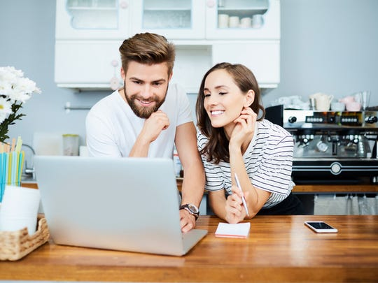 Young man and woman shop online.