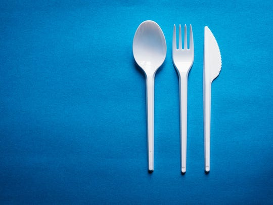 A plastic spoon, fork and knife
