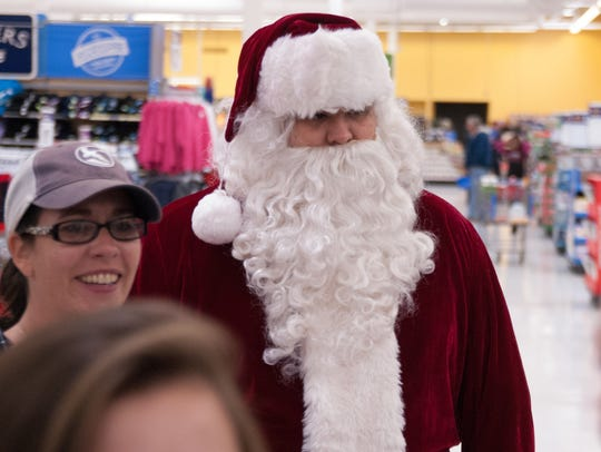 Santa checks on the progress during Shop with a Cop