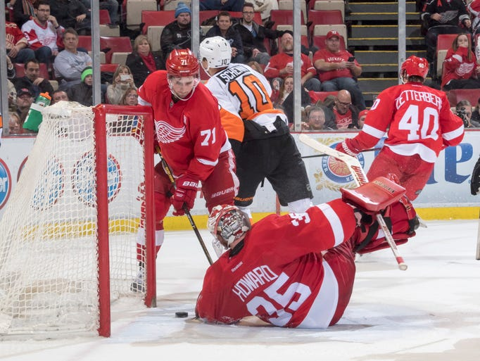 Detroit center Dylan Larkin and goalie Jimmy Howard