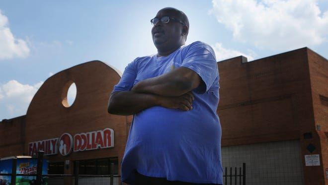 Albert Jackson of Evanston stands outside of the Family Dollar store in Avondale that he was recently fired from after stopping a theft.