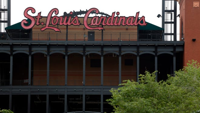 With the St. Louis Cardinals out of town on a road trip, Busch Stadium sits quiet Wednesday, June 17, 2015, in St. Louis. The team said Wednesday it hired a law firm several months ago to conduct an internal inquiry and to assist the FBI and Justice Department in their investigation into possible computer hacking of the Houston Astros database by members of the Cardinals organization.