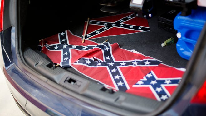 Confederate flags sit in the back of a police car July 30, 2015, outside Ebenezer Baptist Church in Atlanta.