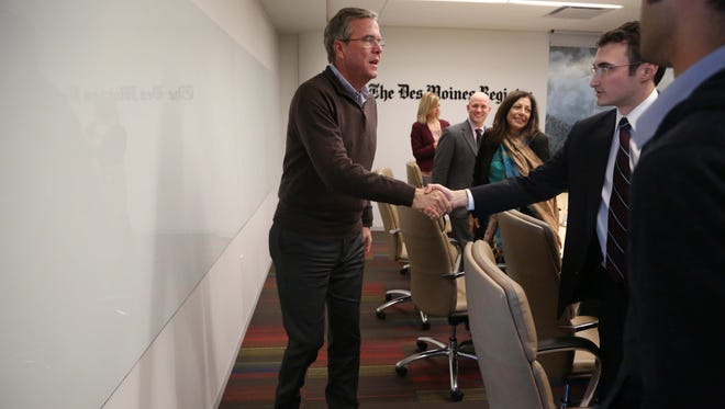 Presidential hopeful, Jeb Bush shakes hands with Register reporter Matthew Patane before meeting with the Des Moines Register editorial board on Tuesday, Jan. 12, 2016, in Des Moines.