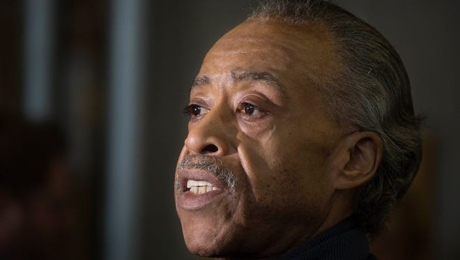 The Rev. Al Sharpton talks to reporters after meeting with Democratic presidential candidate Hillary Clinton, Feb. 16, 2016, in New York.