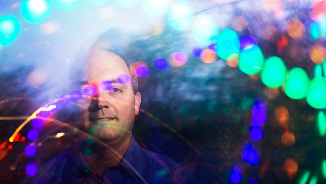 David Clardy of Anderson stands for a portrait amidst the Christmas-themed light show he and his family created in front of their home on Tuesday, December 13, 2016 in Anderson. The Clardy family forwards any donations given to them for putting on the light show to the Family Promise charity.
