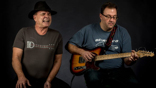 Ralph Giese, of Port Huron, performs his open mouth whistling alongside guitarist Brian Sprung, of Chicago. The two are putting together a CD of original songs.