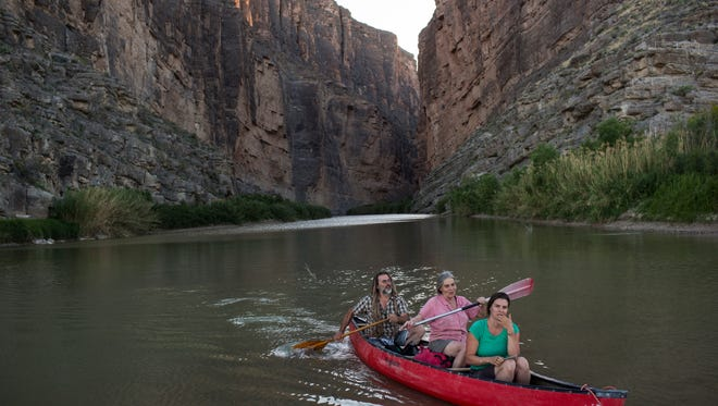 Tourists kayak through Santa Elena Canyon on the Rio Grande river, along a cliff face that is Mexico, left, at Big Bend National Park in Texas, Monday, March 27, 2017. Here the Rio Grande slides between two sheer cliff faces, one in Mexico and one in the United States, that tower 1,500 feet above the water.