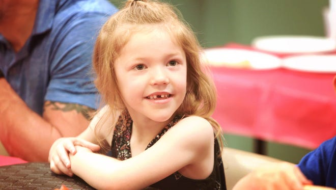 Addyson Benton smiles during her sixth birthday party at Entertrainment Junction, in West Chester, on Saturday, June 17. Two years ago, the Benton family packed a truck and left their family and friends to join the tide of medical-marijuana refugees to Colorado. They wanted the right to obtain a doctorÕs prescription for marijuana oils, patches and other products to treat AddysonÕs severe seizure disorder called myoclonic epilepsy. With medical marijuana now legal in Ohio, the Benton family has returned home.