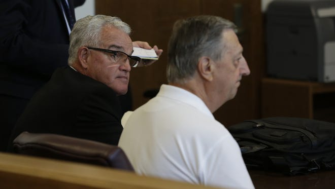 Former UW-Oshkosh Chancellor Richard Wells and former Vice Chancellor Thomas Sonnleitner appear Monday, June 11, 2018, before Winnebago County Circuit Court Commissioner Bryan Keberlein for an initial appearance.
