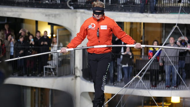 Nik Wallenda walks across the Chicago skyline blindfolded for Discovery Channel's 'Skyscraper Live,' which did not do as well as his walk across the Grand Canyon last year.
