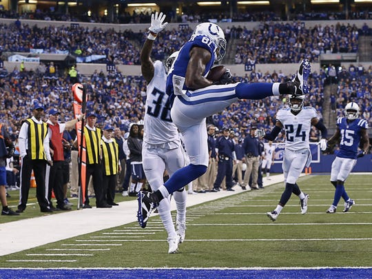 Indianapolis Colts wide receiver Andre Johnson (81) pulls in a touchdown pass from quarterback Ryan Lindley (3) late in the first half against the Tennessee Titans at Lucas Oil Stadium on Jan. 3, 2016.