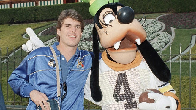 Jim Harbaugh, left, hangs out with Goofy at Disneyland on Dec. 27, 1986.