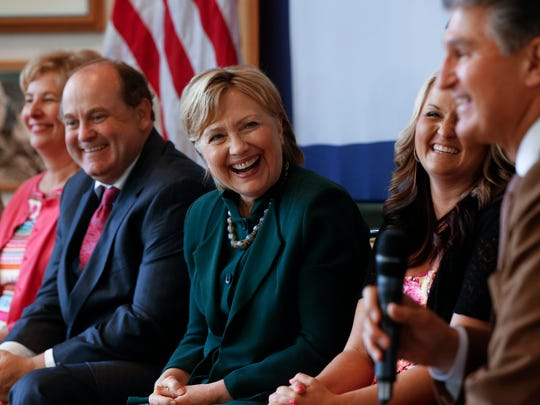 Hillary Clinton laughs while listening to Sen. Joe Manchin, D-W. Va., right, during a campaign stop in Charleston, W. Va., on May 3, 2016.