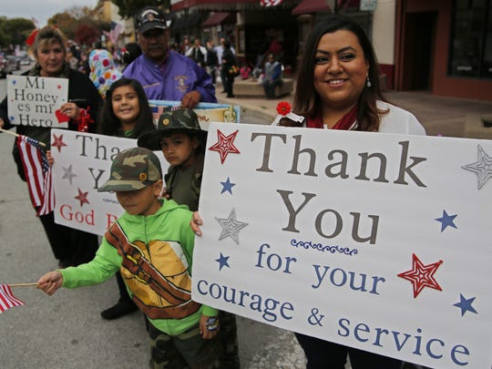 The Garcia Family of Salinas shows their support for veterans during the 2014 annual Salinas Veterans Day Parade