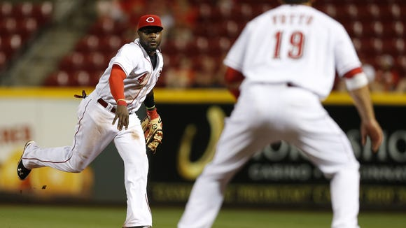 Brandon Phillips and Joey Votto (19) won't return to the Reds anytime soon.