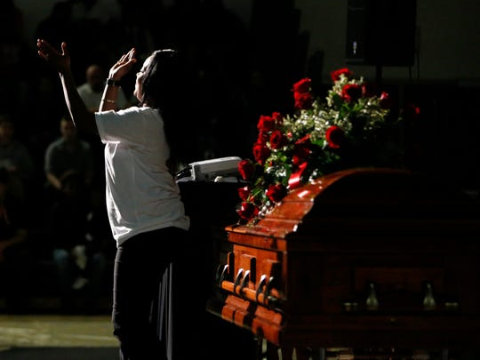 "Katrina Johnson, mother of Kedarie Johnson, stands up and dances to the song ""Joyful, Joyful"" from the movie ""Sister Act 2"" on Wednesday, March 9, 2016, to close out the funeral service for her 16-year-old son at Burlington High School in Burlington, Iowa."
