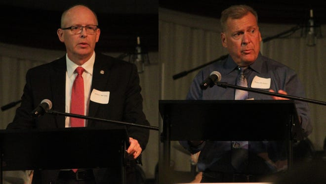 Bill King, left, and Phillip Biston, right, both candidates for First District Commissioner for Adair County, speak during a candidate forum.