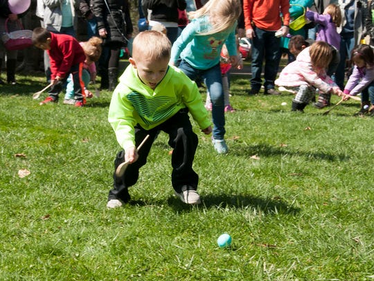 Tyler Russell, 4, of Springboro, concentrates while rolling an egg across the lawn of the Rutherford B. Hayes property. Hundreds of children participated in the annual Easter Egg Roll at the Rutherford B. Hayes Home and Museum in  Fremont on Saturday.