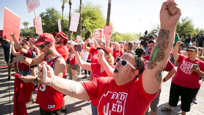 Maria Imperial, a reading interventionist teacher at Copper King Elementary in Phoenix, cheers at the #RedForEd rally at the Arizona Capitol in Phoenix on the second day of the Arizona teacher walkout, April 27, 2018.