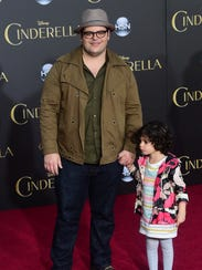 Actor Josh Gad and his daughter pose on arrival for