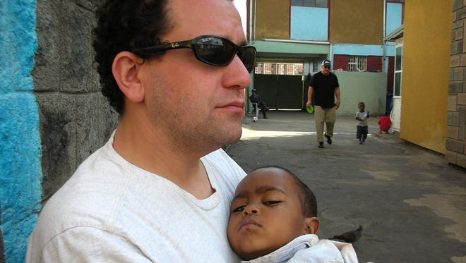 Matthew Frankel and his newly adopted son in Addis Ababa, January 2009.