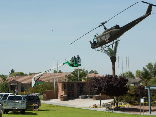 Work to repair the broken windows in the cockpit of the UH-1 Iroquois at Veterans Memorial Park started Monday, July 23, 2018 and will continue through the week.