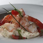 The Shrimp and Grits dish created by chef Paul Fehribach of the Big Jones restaurant in Chicago. June 24, 2015