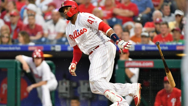 Philadelphia Phillies first baseman Carlos Santana (41) hits an RBI single during the third inning against the Atlanta Braves at Citizens Bank Park. Mandatory Credit: Eric Hartline-USA TODAY Sports