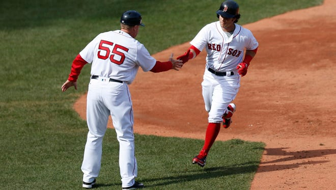 Boston Red Sox left fielder Andrew Benintendi (16) rounds third base after hitting a home run during the fifth inning against the Pittsburgh Pirates at Fenway Park on April 3.