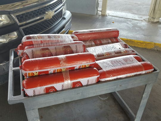 Rolls of Mexican bologna are placed atop a cart at