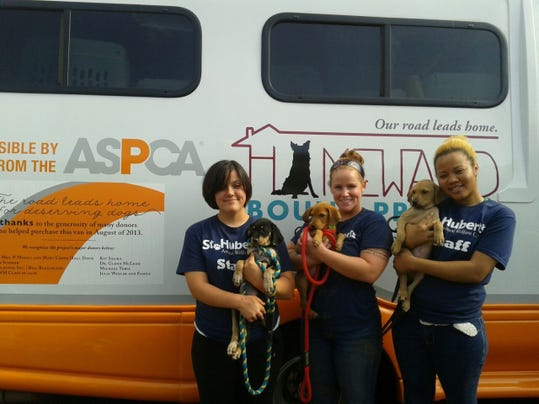 2014  puppies with staff members Kim, Colleen, and Alyssa.jpg