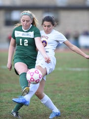 Spackenkill's Eileen Fiore and Rhinebeck's Barr Lavi-Romer collide during Wednesday's game in Rhinebeck.