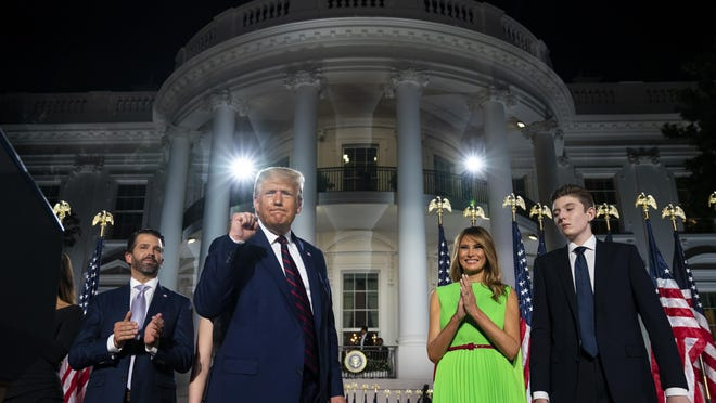 From left: Donald Trump Jr., President Donald Trump, first lady Melania Trump and Barron Trump stand on the South Lawn of the White House on the fourth day of the Republican National Convention Thursday in Washington.
