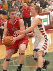 Port Clinton's Joe Brenner drives to the basket Friday against Oak Harbor's Kyle Pape.