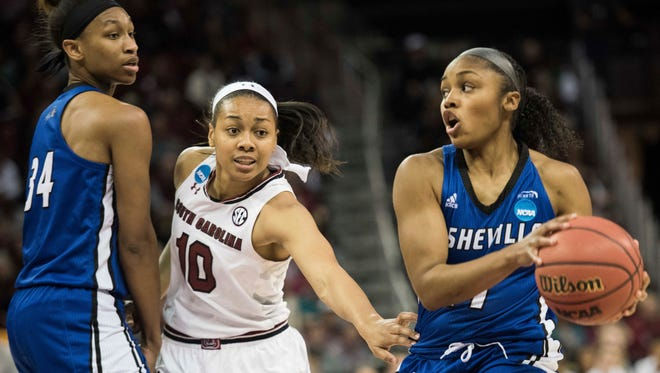 North Carolina Asheville guard Khaila Webb (11), with North Carolina Asheville center Bronaza Fitzgerald (34), drives to the hoop against South Carolina guard Allisha Gray (10) during a first-round game in the women's NCAA college basketball tournament Friday in Columbia.