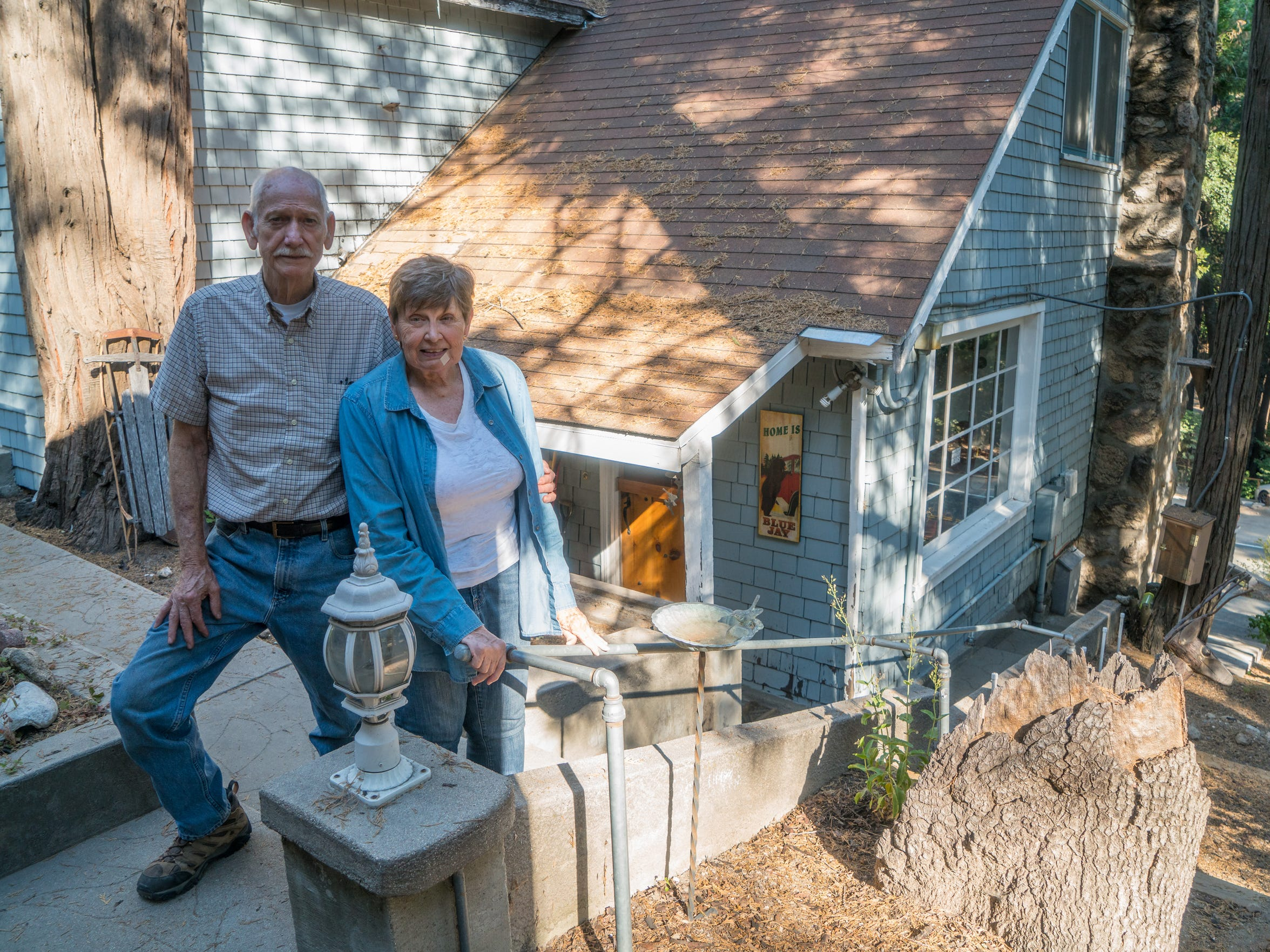 Sharon and Don Bailey stand outside their home in Blue Jay in the San Bernardino Mountains. The Baileys have learned to use much less water since their well began to fail in February.