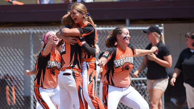 Solon players celebrate after winning the Class 3-A state softball championship on Friday.