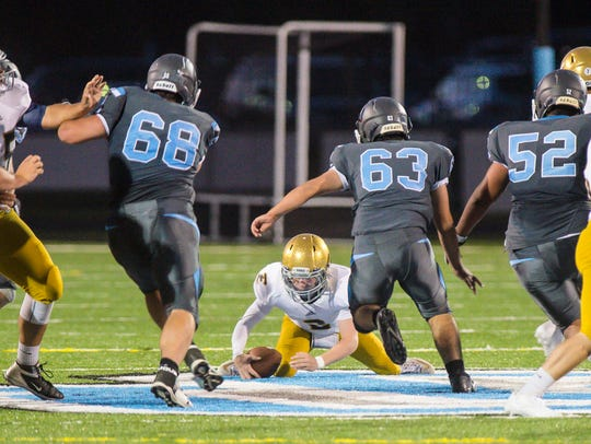 Essex's Cam Quinn scoops up his fumble against South