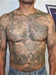 Ernesto H.E., an alleged Barrio Azteca gang hit man,