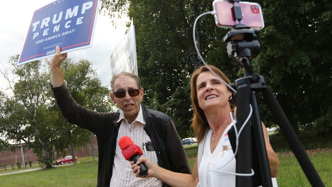 Alan Dechter, of Newton, and Dianna Ploss, organizer of the rally in support of President Trump, livestream the event in Concord Tuesday afternoon, Sept. 1, 2020.
