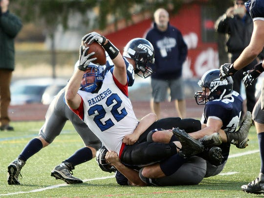 U-32's Colby Brochu scores in the Otters' 33-14 win