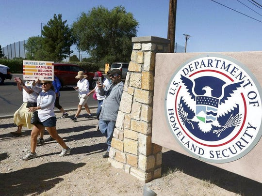 This June 2018 file photo shows protesters walking along Montana Avenue outside the El Paso Processing Center, in El Paso, Texas. The U.S. government has suddenly stopped force-feeding a group of men on a hunger strike inside a Texas immigration detention center, U.S. Immigration and Customs Enforcement said Thursday, Feb. 14, 2019. The dramatic reversal comes as public pressure was mounting on ICE to halt the practice, which involves feeding detainees through nasal tubes against their will.