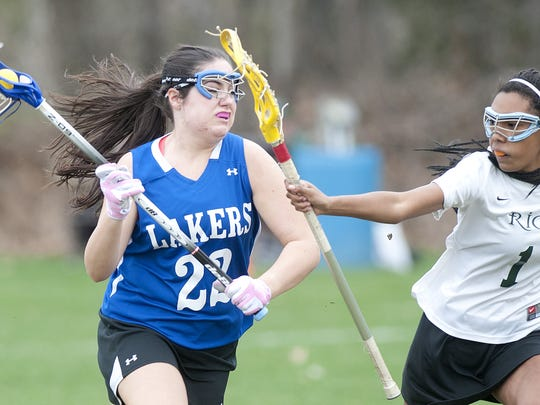 Colchester High School and senior attack Ciara St. Armour, left, seen in action in a game last season, played their first varsity girls lacrosse game on Tuesday.